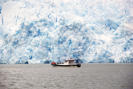Boat in front of the San Rafael Glacier, Patagonia Chile. It is one of the major outlet glacier of the Northern Patagonia Ice Field in southern Chile and it is the glacier nearest the Equator.