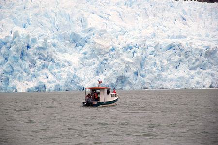 Boat in the San Rafael Lagoon with theSan Rafael Glacier in the background, Patagonia Chile. It is one of the major outlet glacier of the Northern Patagonia Ice Field in southern Chile and it is the glacier nearest the Equator.