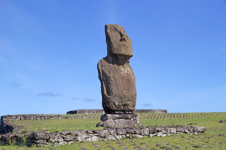 Moai at the Easter Island, Rapa Nui, Chile. Tahai archaeological site. Easter Island is a Chilean island in the southeastern Pacific Ocean. It is famous for its 887 extant monumental statues called moai