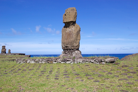 rapanui: Moai at the Easter Island, Rapa Nui, Chile. Tahai archaeological site. Easter Island is a Chilean island in the southeastern Pacific Ocean. It is famous for its 887 extant monumental statues called moai