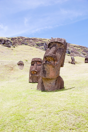 Moai at the Rano Raraku archaeological site, Easter Island, Rapa Nui, Chile. Easter Island is a Chilean island in the southeastern Pacific Ocean. It is famous for its 887 extant monumental statues called moai Stock Photo - 85090406
