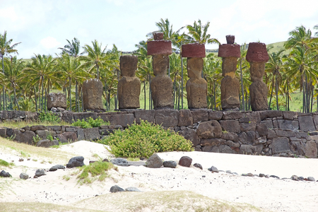 Moai, Ahu Nao Nao at the Anakena beach, Easter Island, Rapa Nui, Chile. Easter Island is a Chilean island in the southeastern Pacific Ocean. It is famous for its 887 extant monumental statues called moai