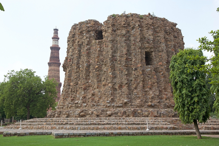 Alai Minar with Qutab Minar in the background in Delhi, India. It is a minaret, the construction was abandoned, that forms of the Qutab complex, a UNESCO World Heritage Site