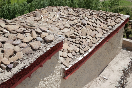 Mani stones at the Stok Palace in Ladakh, India. Mani stone, inscribed with a mantra,  is a form of prayer in Tibetan Buddhism Editorial