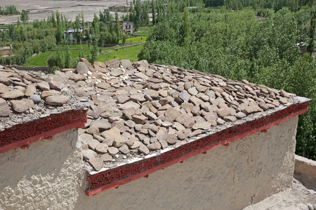 Mani stones at the Stok Palace in Ladakh, India. Mani stone, inscribed with a mantra,  is a form of prayer in Tibetan Buddhism Editöryel