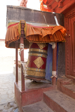 Prayer wheel at the Stok Palace in Ladakh, India. Mani stone, inscribed with a mantra,  is a form of prayer in Tibetan Buddhism Stok Fotoğraf