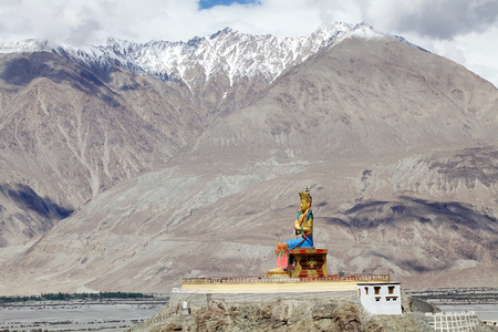 Statue of Buddha near Diskit Monastery in Nubra Valley, Ladakh, India. It is a 32 metre statue facing down the Shyok River towards Pakistan. Stock Photo