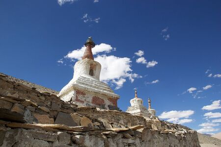 Stupas at the Karzok village on the shore of Tso Moriri Lake In Ladakh region in the Indian state of Jammu and Kashmir. The mountain lake is at an altitude of 4522 m in the Changthang Plateau Stock Photo