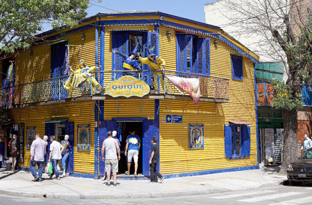 People along the street in La Boca in Buenos Aires, Argentina. La Boca is a neighbourhood, barrio of Argentine capital, in Buenos Aires