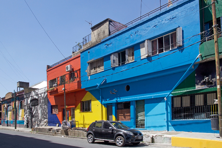 Brightly painted houses in La Boca in Buenos Aires, Argentina. La Boca is a neighbourhood, barrio of Argentine capital, in Buenos Aires