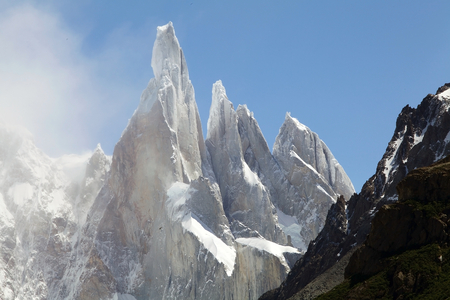 Cerro Torre, Torre Egger, Punta Herron and Aguja Standhart at the Los Glaciare National Park in Patagonia, Argentina. Laguna Torre ia a popular site for hikers and climbers to see surroundings peaks, including the Cerro Torre