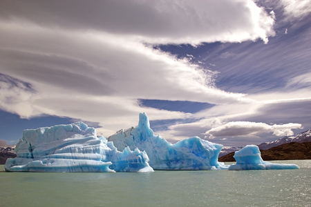 Icebergs from Upsala Glacier with amazing sky in the Argentino Lake, Argentina. Argentino Lake is the biggest freshwater lake in Argentina. Stock Photo