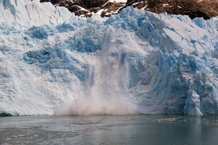 Ice collapses at the Spegazzini Glacier, view from the Argentino Lake, Argentina. Spegazzini Glacier is grounded on the bottom of the lake, which depth in this area is around 150 meters