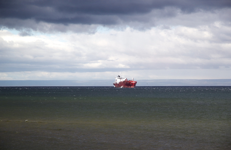 Ship view from Punta Arenas, Chile. Punta Arenas is the capital city of the Magallanes and Antartica Chilena Stock Photo