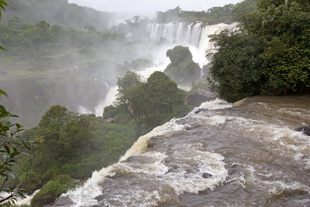 Iguazu Falls in the Argentine side. Iguazu Falls are waterfalls of Iguazu River on the border of the Argentine province of Misiones and the Brasilian state of Parana Imagens
