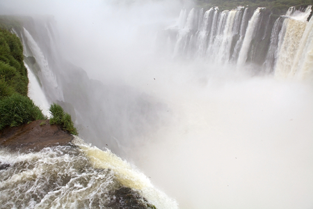 Devils Throat of Iguazu Falls view from the Argentine side. Iguazu Falls are waterfalls of Iguazu River on the border of the Argentine province of Misiones and the Brasilian state of Parana