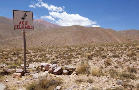 Mobil phone signal limit at the Abra del Condor, a high mountain pass at an elevation of 4000 m above the sea level located on the border of Salta and Jujuy Province, in northwestern Argentina. The area features dramatic mountainous landscape