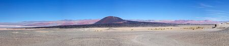 Volcano Caraci Pampa at the Puna de Atacama, Argentina. Puna de Atacama is an arid high plateau in the Andes of northern Chile and Argentina. In Argentina Puna's territory is extended in the provinces of Salta, Jujuy and Catamarca