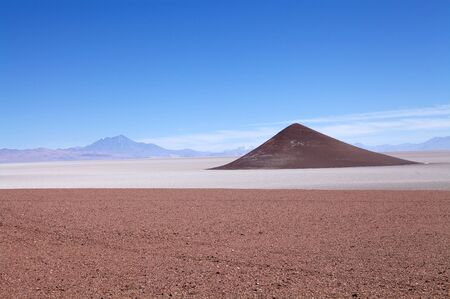 Cono de Arita in Salar of Arizaro at the Puna de Atacama, Argentina. Salar of Arizaro is a large salt flat of the Andes in north-western Argentina and it covers an area of 1600 sq km
