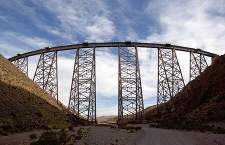 La Polvorilla viaduct in Salta Province at the Puna de Atacama, Argentina. The viaduct is run by the Train to the Clouds, a tourist train service in the Andes mountain range, over 4200 m