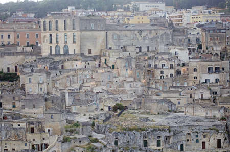 The Sassi of Matera in Matera, Italy. The Sassi of Matera are two district, Sasso Caveoso and Sasso Barisano, of the italian city of Matera, Basilicata, known for their ancient cave dwellings inhabited since the Paleolithic period.