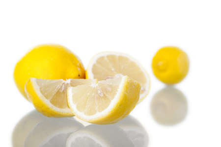 Lemons in white background, with reflection. Studio shot. Stock Photo - 14411854