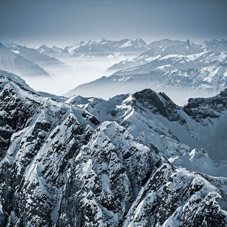 Snowy mountains in the Swiss Alps. View from Mount Titlis, Switzerland. photo