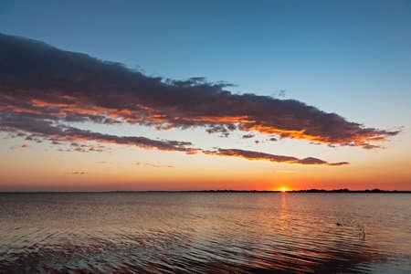Beautiful sunset over water in Aveiro, Portugal Фото со стока