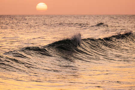 breaking wave: Beautiful breaking wave at sunset. Algarve, Portugal Stock Photo