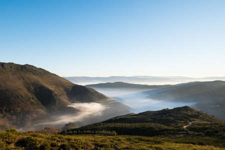 Beautiful view of a misty valley in the north of Serra do Marao, Portugal
