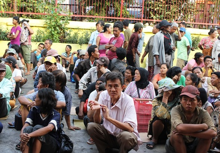 beggar's: Jakarta, Indonesia, February 6, 2012 - Poor people visited and gathered in courtyard of the oldest temple for get alms.