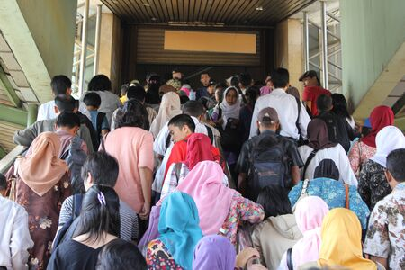 Jakarta, Indonesia, 7 February 2012 - Crowd of passengers at a railway station.