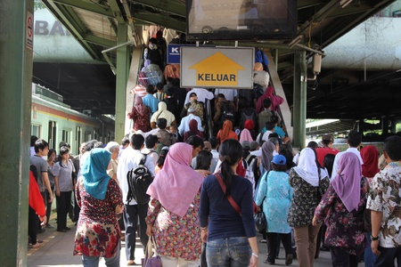 Jakarta, Indonesia, 7 February 2012 - Crowd of passengers at a railway station. Editorial