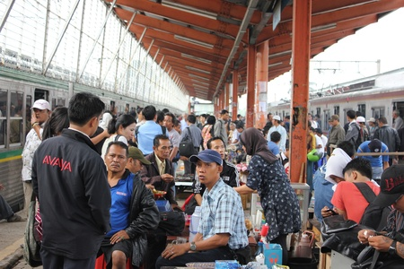 Jakarta, Indonesia, 28 February 2012 - Crowd people at the railway station.