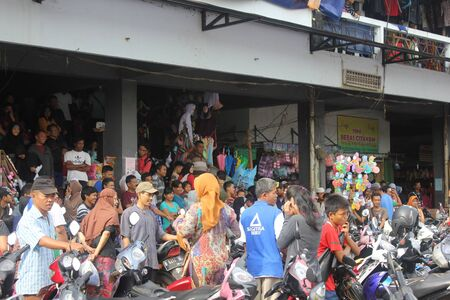 Jakarta, Indonesia, 10 March 2012 - People in traditional market near outskirts of Jakarta.