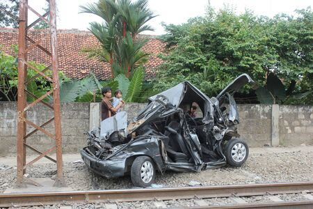 Jakarta, Indonesia, 18 March 2012 - Crushed car hit by a commuter train in Depok, a suburbs of Jakarta on Saturday night 17 March 2012. Editorial