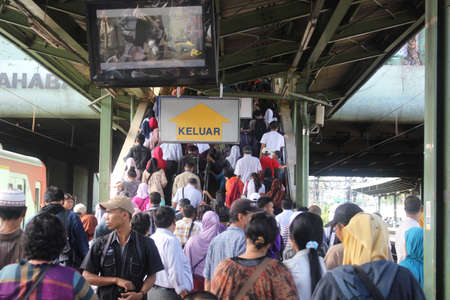 Jakarta, Indonesia, 21 March 2012 - Crowd at railway station of Jakarta. Editorial