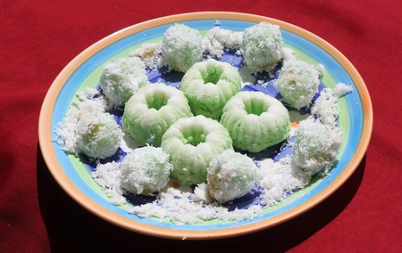 Indonesian food is know as kelepon, a cake made from glutinous rice and grated coconut
