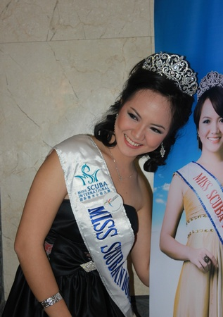 Jakarta, Indonesia, 29 March, 2012 - Miss Scuba Indonesia 2011, Nendy Yunizar, at the opening of the Deep Indonesia 2012, international diving, adventure travel and water sports exhibition. Stock Photo - 12904064