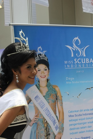 Jakarta, Indonesia, March 29, 2012 - Miss Scuba International 2011, Dayu Prastini Hatmanti, is at the opening of the Deep Indonesia 2012, Indonesias 6th international diving, adventure, travel and water sports exhibition. Editorial