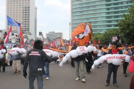 happening: Jakarta, Indonesia, 1 May 2012 - A group of workers held happening art in the peaceful workers rally to mark May Day.