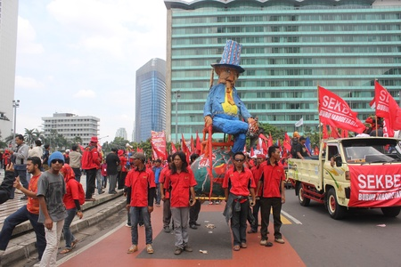 happening: Jakarta, Indonesia, 1 May 2012 - A group of workers held happening art in peaceful workers rally to mark May Day demanding better pay.