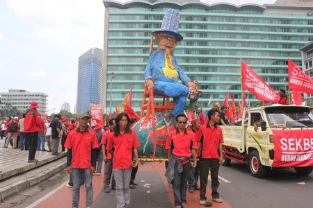 Jakarta, Indonesia, 1 May 2012 - A group of workers held happening art in peaceful workers rally to mark May Day demanding better pay. Stock Photo - 13685794