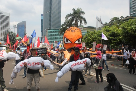 Jakarta, Indonesia, 1 May 2012. Workers from several union held a peaceful rally to mark May Day on in the capital demanding better pay and an end to outsourcing, and demands that May 1 be declared a public holiday. Stock Photo - 13685796