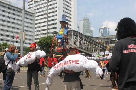 happening: Jakarta, Indonesia, 1 May 2012 - A group of workers held a happening art in workers rally to mark Labor Day.