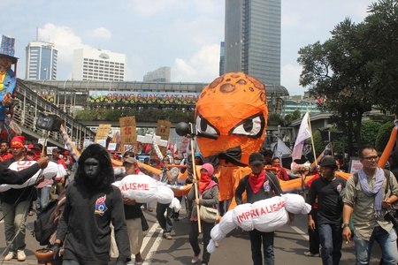 happening: Jakarta, Indonesia, 1 May 2012 - A journalists associations held happening art in workers peaceful rally to mark Labor Day.