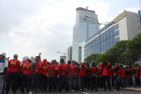 Jakarta, Indonesia, 1 May 2012. Thousands of Indonesian workers held a peaceful rally to mark May Day on Tuesday in the capital demanding better pay and an end to outsourcing, and demands that May 1 be declared a public holiday. Stock Photo - 13685753