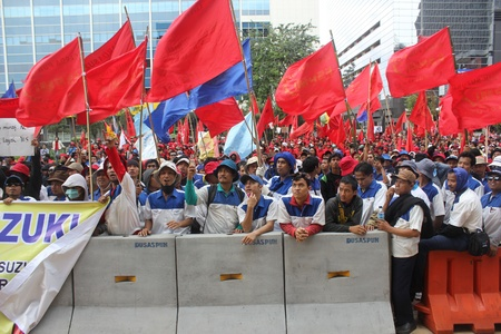 Jakarta, 1 May 2012 - Workers of Suzuki take a part in Labor Day rally in capital demanding better pay and end outsourcing.