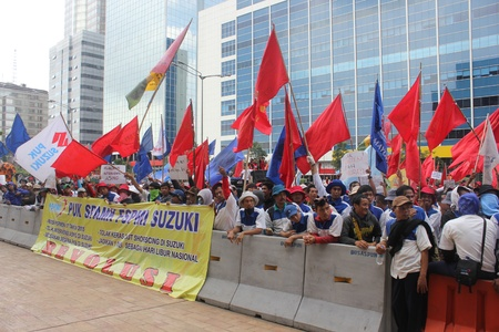 Jakarta, Indonesia, 1 May 2012. Thousands of Indonesian workers held a peaceful rally to mark May Day on Tuesday in the capital demanding better pay and an end to outsourcing, and demands that May 1 be declared a public holiday. Stock Photo - 13685771