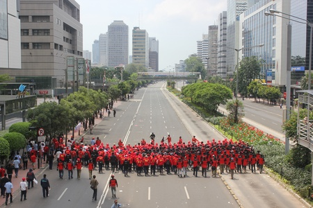 Jakarta, Indonesia, 1 May 2012. Thousands of Indonesian workers held a peaceful rally to mark May Day on Tuesday in the capital demanding better pay and an end to outsourcing, and demands that May 1 be declared a public holiday.